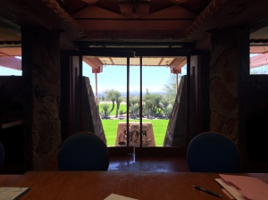 View out of the glass doors from the former dining room at Taliesin West is aligned with the distant landscape.