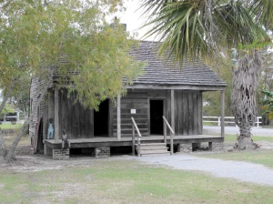 Slave cabin with contemporary sculptures at Whitney Plantation, Louisiana.
